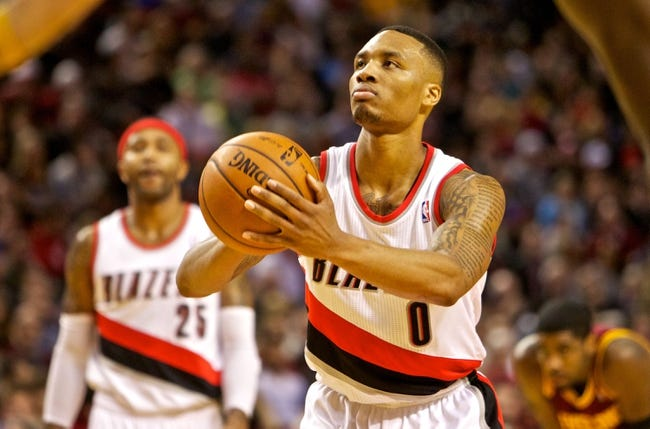 Jan 15, 2014; Portland, OR, USA; Portland Trail Blazers point guard Damian Lillard (0) shoots a free throw against the Cleveland Cavaliers at the Moda Center. Mandatory Credit: Craig Mitchelldyer-USA TODAY Sports