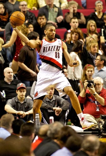Jan 15, 2014; Portland, OR, USA; Portland Trail Blazers small forward Nicolas Batum (88) saves the ball from going out of bounds against the Cleveland Cavaliers at the Moda Center. Mandatory Credit: Craig Mitchelldyer-USA TODAY Sports