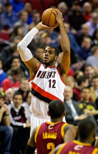 Jan 15, 2014; Portland, OR, USA; Portland Trail Blazers power forward LaMarcus Aldridge (12) shoots over Cleveland Cavaliers point guard Kyrie Irving (2) at the Moda Center. Mandatory Credit: Craig Mitchelldyer-USA TODAY Sports