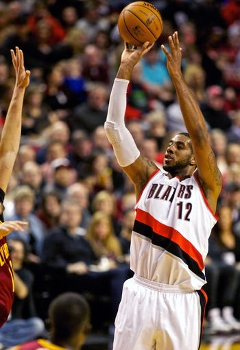 Jan 15, 2014; Portland, OR, USA; Portland Trail Blazers power forward LaMarcus Aldridge (12) shoots against the Cleveland Cavaliers at the Moda Center. Mandatory Credit: Craig Mitchelldyer-USA TODAY Sports