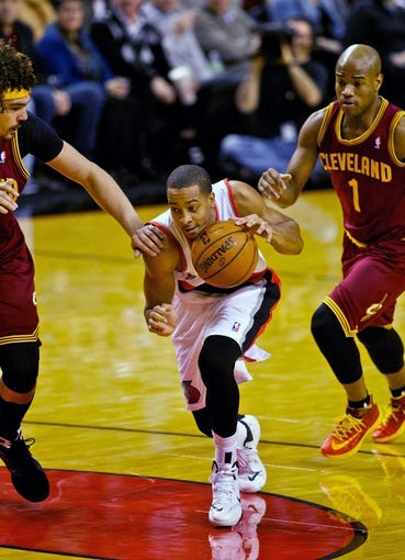 Jan 15, 2014; Portland, OR, USA; Portland Trail Blazers shooting guard C.J. McCollum (3) drives past Cleveland Cavaliers center Anderson Varejao (17) and point guard Jarrett Jack (1) at the Moda Center. Mandatory Credit: Craig Mitchelldyer-USA TODAY Sports
