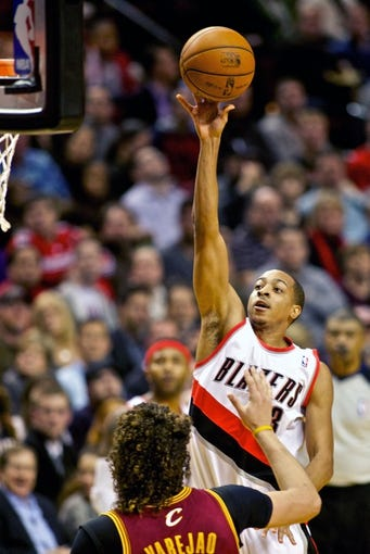 Jan 15, 2014; Portland, OR, USA; Portland Trail Blazers shooting guard C.J. McCollum (3) shoots over Cleveland Cavaliers center Anderson Varejao (17) at the Moda Center. Mandatory Credit: Craig Mitchelldyer-USA TODAY Sports