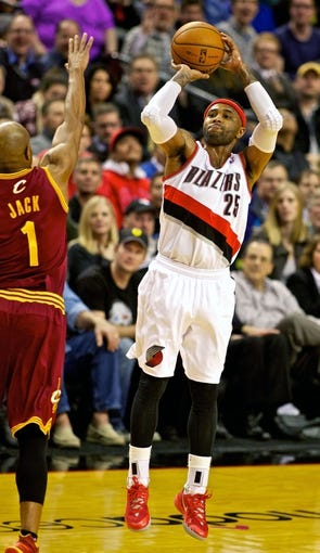 Jan 15, 2014; Portland, OR, USA; Portland Trail Blazers point guard Mo Williams (25) shoots over Cleveland Cavaliers point guard Jarrett Jack (1) at the Moda Center. Mandatory Credit: Craig Mitchelldyer-USA TODAY Sports