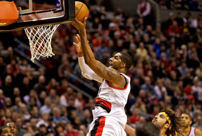 Jan 15, 2014; Portland, OR, USA; Portland Trail Blazers power forward LaMarcus Aldridge (12) shoots the ball in front of Cleveland Cavaliers center Anderson Varejao (17) in the fourth quarter at the Moda Center. Mandatory Credit: Craig Mitchelldyer-USA TODAY Sports