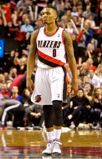 Jan 15, 2014; Portland, OR, USA; Portland Trail Blazers point guard Damian Lillard (0) celebrates after scoring in the fourth quarter against the Cleveland Cavaliers at the Moda Center. Mandatory Credit: Craig Mitchelldyer-USA TODAY Sports