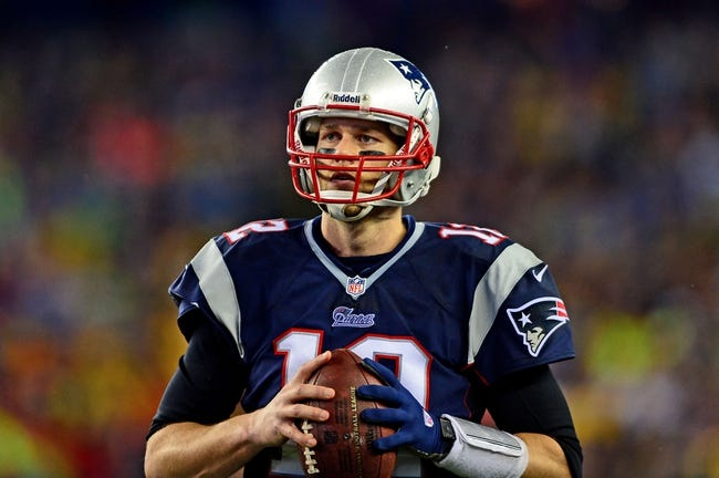 Jan 11, 2014; Foxborough, MA, USA; New England Patriots quarterback Tom Brady (12) during the fourth quarter of the 2013 AFC divisional playoff football game against the Indianapolis Colts at Gillette Stadium. Mandatory Credit: Andrew Weber-USA TODAY Sports