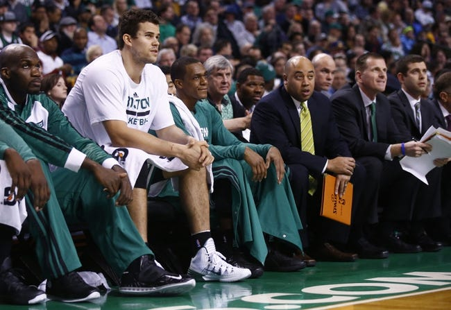 Jan 17, 2014; Boston, MA, USA; Boston Celtics point guard Rajon Rondo (9) (center) on the bench as they take on the Los Angeles Lakers in the first quarter at TD Garden. Mandatory Credit: David Butler II-USA TODAY Sports
