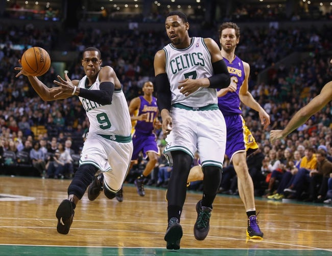 Jan 17, 2014; Boston, MA, USA; Boston Celtics point guard Rajon Rondo (9) drives the ball against the Los Angeles Lakers in the first quarter at TD Garden. Mandatory Credit: David Butler II-USA TODAY Sports