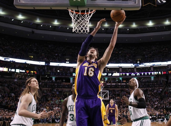 Jan 17, 2014; Boston, MA, USA; Los Angeles Lakers center Pau Gasol (16) shoots against the Boston Celtics in the first quarter at TD Garden. Mandatory Credit: David Butler II-USA TODAY Sports