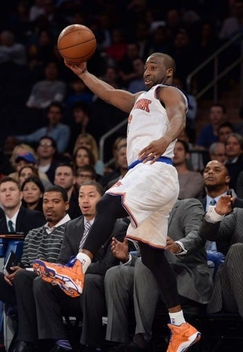 Jan 17, 2014; New York, NY, USA; New York Knicks point guard Raymond Felton (2) saves a ball from going out of bounds against the Los Angeles Clippers during the first half at Madison Square Garden. The Los Angeles Clippers won 109-94. Mandatory Credit: Joe Camporeale-USA TODAY Sports