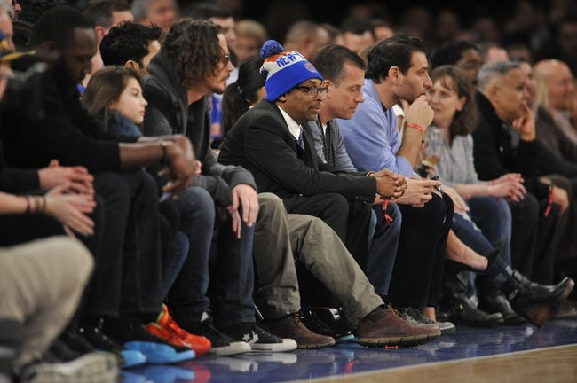 Jan 17, 2014; New York, NY, USA; Actor and director Spike Lee looks on during the first half of the game between the New York Knicks and the Los Angeles Clippers at Madison Square Garden. The Los Angeles Clippers won 109-94. Mandatory Credit: Joe Camporeale-USA TODAY Sports