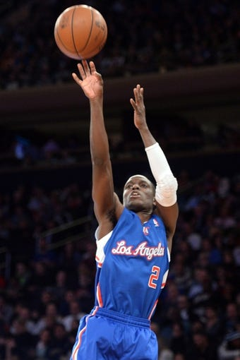 Jan 17, 2014; New York, NY, USA; Los Angeles Clippers point guard Darren Collison (2) takes a shot against the New York Knicks during the first half at Madison Square Garden. The Los Angeles Clippers won 109-94. Mandatory Credit: Joe Camporeale-USA TODAY Sports