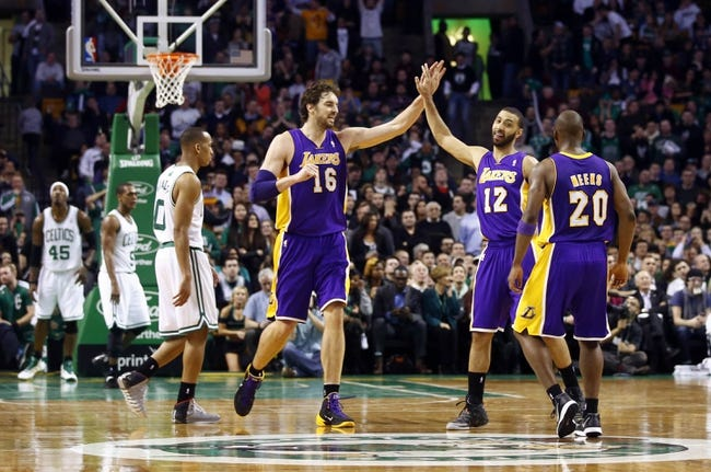Jan 17, 2014; Boston, MA, USA; Los Angeles Lakers center Pau Gasol (16) and point guard Kendall Marshall (12) react after a play against the Boston Celtics in the second half at TD Garden. The Los Angeles Lakers defeated the Celtics 107-104. Mandatory Credit: David Butler II-USA TODAY Sports