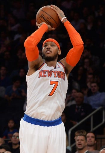 Jan 17, 2014; New York, NY, USA; New York Knicks small forward Carmelo Anthony (7) shoots against the Los Angeles Clippers during the second half at Madison Square Garden. The Los Angeles Clippers won 109-94. Mandatory Credit: Joe Camporeale-USA TODAY Sports