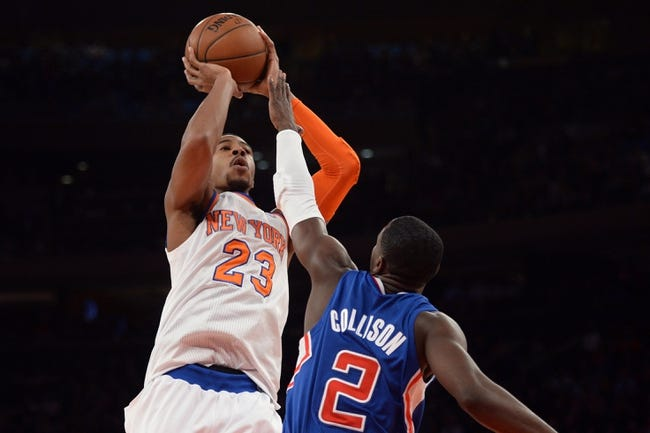 Jan 17, 2014; New York, NY, USA; New York Knicks shooting guard Toure' Murry (23) shoots over Los Angeles Clippers point guard Darren Collison (2) during the second half at Madison Square Garden. The Los Angeles Clippers won 109-94. Mandatory Credit: Joe Camporeale-USA TODAY Sports