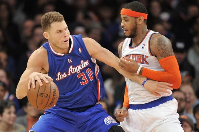 Jan 17, 2014; New York, NY, USA; New York Knicks small forward Carmelo Anthony (7) guards Los Angeles Clippers power forward Blake Griffin (32) during the second half at Madison Square Garden. The Los Angeles Clippers won 109-94. Mandatory Credit: Joe Camporeale-USA TODAY Sports