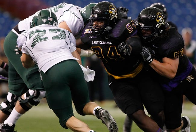 Dec 23, 2013; St. Petersburg, FL, USA; East Carolina Pirates defensive end Johnathon White (94) rushes for Ohio Bobcats running back Beau Blankenship (22) during the first quarter at the 2013 Beef O Bradys Bowl at Tropicana Field. Mandatory Credit: Kim Klement-USA TODAY Sports