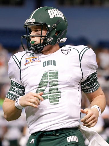 Dec 23, 2013; St. Petersburg, FL, USA; Ohio Bobcats quarterback Tyler Tettleton (4) against the East Carolina Pirates during the first quarter at the 2013 Beef O Bradys Bowl at Tropicana Field. Mandatory Credit: Kim Klement-USA TODAY Sports