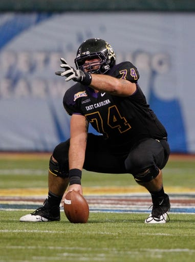 Dec 23, 2013; St. Petersburg, FL, USA;East Carolina Pirates offensive linesman Taylor Hudson (74) points before he hikes the ball against the Ohio Bobcats  during the second quarter at the 2013 Beef O Bradys Bowl at Tropicana Field. Mandatory Credit: Kim Klement-USA TODAY Sports