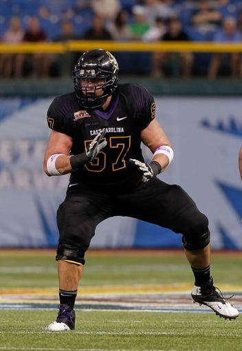 Dec 23, 2013; St. Petersburg, FL, USA; East Carolina Pirates offensive linesman Adhem Elsawi (57) blocks against the Ohio Bobcats  during the second quarter at the 2013 Beef O Bradys Bowl at Tropicana Field. Mandatory Credit: Kim Klement-USA TODAY Sports