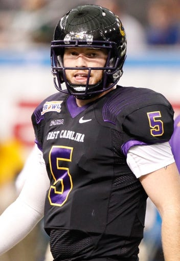 Dec 23, 2013; St. Petersburg, FL, USA; East Carolina Pirates quarterback Shane Carden (5) works out prior to the game against the Ohio Bobcats during the 2013 Beef O Bradys Bowl at Tropicana Field. Mandatory Credit: Kim Klement-USA TODAY Sports