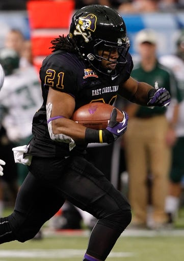 Dec 23, 2013; St. Petersburg, FL, USA; East Carolina Pirates running back Vintavious Cooper (21) runs wth the ball against the Ohio Bobcats during the first quarter at the 2013 Beef O Bradys Bowl at Tropicana Field. Mandatory Credit: Kim Klement-USA TODAY Sports