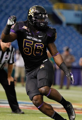 Dec 23, 2013; St. Petersburg, FL, USA; East Carolina Pirates linebacker Derrell Johnson (56) against the Ohio Bobcats during the first quarter at the 2013 Beef O Bradys Bowl at Tropicana Field. Mandatory Credit: Kim Klement-USA TODAY Sports