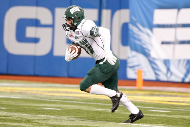 Dec 23, 2013; St. Petersburg, FL, USA; Ohio Bobcats cornerback Devin Bass (37) runs with the ball against the East Carolina Pirates during the first quarter at the 2013 Beef O Bradys Bowl at Tropicana Field. Mandatory Credit: Kim Klement-USA TODAY Sports