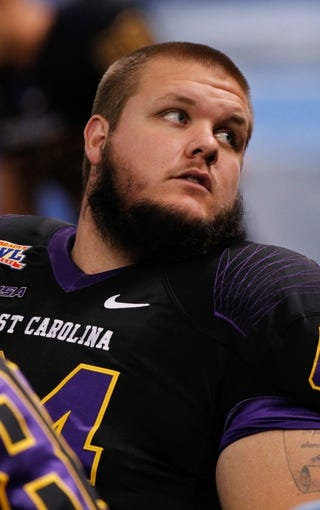 Dec 23, 2013; St. Petersburg, FL, USA; East Carolina Pirates offensive linesman Keifer Neal (64) against the Ohio Bobcats during the second quarter at the 2013 Beef O Bradys Bowl at Tropicana Field. Mandatory Credit: Kim Klement-USA TODAY Sports