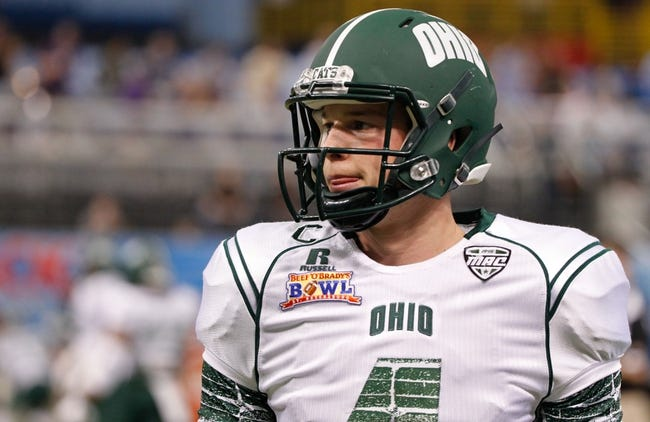 Dec 23, 2013; St. Petersburg, FL, USA; Ohio Bobcats quarterback Tyler Tettleton (4) against the East Carolina Pirates works out prior to the game during the 2013 Beef O Bradys Bowl at Tropicana Field. Mandatory Credit: Kim Klement-USA TODAY Sports