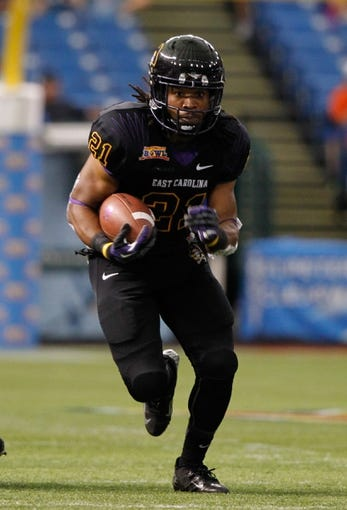 Dec 23, 2013; St. Petersburg, FL, USA;East Carolina Pirates running back Vintavious Cooper (21) runs with the ball against the Ohio Bobcats during the first quarter at the 2013 Beef O Bradys Bowl at Tropicana Field. Mandatory Credit: Kim Klement-USA TODAY Sports