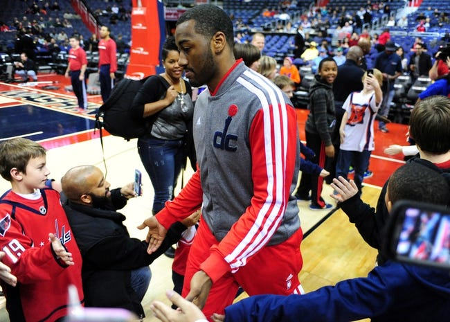 Jan 18, 2014; Washington, DC, USA; Washington Wizards guard John Wall (center) high fives fans prior to the game against the Detroit Pistons at Verizon Center. Mandatory Credit: Evan Habeeb-USA TODAY Sports