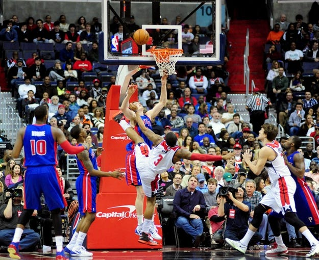 Jan 18, 2014; Washington, DC, USA; Washington Wizards guard Bradley Beal (3) gets knocked to the ground while shooting against Detroit Pistons forward Kyle Singler (25) at Verizon Center. Mandatory Credit: Evan Habeeb-USA TODAY Sports