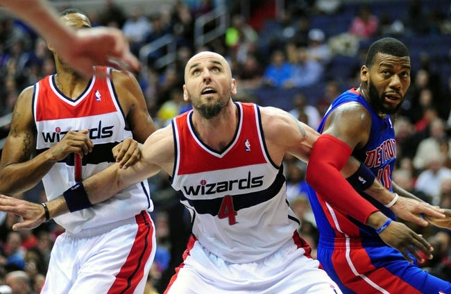 Jan 18, 2014; Washington, DC, USA; Washington Wizards center Marcin Gortat (4) fights for a loose ball with Detroit Pistons forward Greg Monroe (10) at Verizon Center. Mandatory Credit: Evan Habeeb-USA TODAY Sports