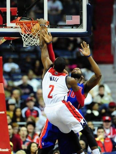 Jan 18, 2014; Washington, DC, USA; Washington Wizards guard John Wall (2) dunks the ball over Detroit Pistons forward Greg Monroe (10) at Verizon Center. Mandatory Credit: Evan Habeeb-USA TODAY Sports