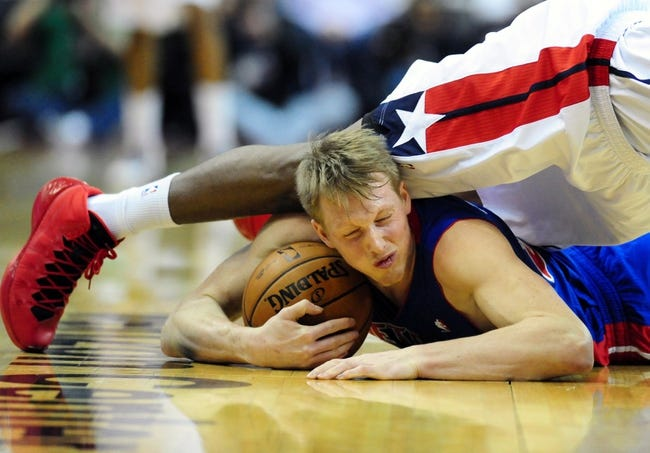 Jan 18, 2014; Washington, DC, USA; Detroit Pistons forward Kyle Singler (25) fights for a loose ball during the game against the Washington Wizards at Verizon Center. Mandatory Credit: Evan Habeeb-USA TODAY Sports