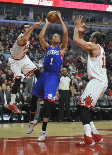 Jan 18, 2014; Chicago, IL, USA;  Chicago Bulls shooting guard Kirk Hinrich (left) and center Joakim Noah (right) defend Philadelphia 76ers point guard Michael Carter-Williams (1) during the first quarter at the United Center. Mandatory Credit: David Banks-USA TODAY Sports