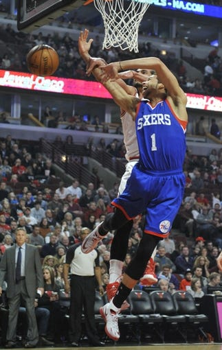 Jan 18, 2014; Chicago, IL, USA;  Chicago Bulls  center Joakim Noah (13) blocks Philadelphia 76ers point guard Michael Carter-Williams (1) shot during the first quarter at the United Center. Mandatory Credit: David Banks-USA TODAY Sports
