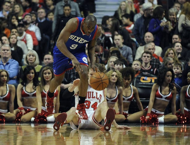 Jan 18, 2014; Chicago, IL, USA; Philadelphia 76ers shooting guard James Anderson (9) steals the ball from Chicago Bulls small forward Mike Dunleavy (34) during the first quarter at the United Center. Mandatory Credit: David Banks-USA TODAY Sports