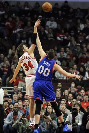 Jan 18, 2014; Chicago, IL, USA; Philadelphia 76ers center Spencer Hawes (00) defends Chicago Bulls small forward Mike Dunleavy (34) during the first quarter at the United Center. Mandatory Credit: David Banks-USA TODAY Sports