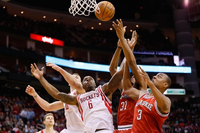 Jan 18, 2014; Houston, TX, USA; Houston Rockets forward Terrence Jones (6) battles for a rebound with Milwaukee Bucks forward Caron Butler (3) and center John Henson (31) during the first half at Toyota Center. Mandatory Credit: Soobum Im-USA TODAY Sports