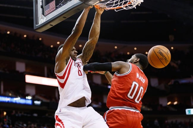 Jan 18, 2014; Houston, TX, USA; Houston Rockets forward Terrence Jones (6) dunks over Milwaukee Bucks guard O.J. Mayo (0) during the first half at Toyota Center. Mandatory Credit: Soobum Im-USA TODAY Sports
