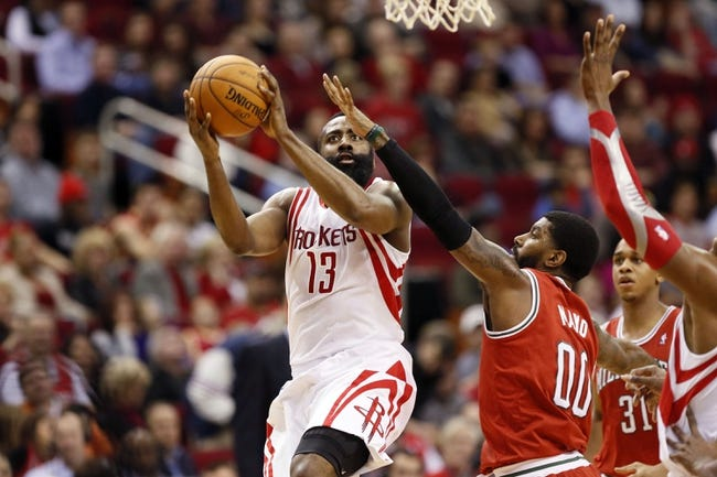 Jan 18, 2014; Houston, TX, USA; Houston Rockets guard James Harden (13) drives to the basket as Milwaukee Bucks guard O.J. Mayo (0) defends during the first half at Toyota Center. Mandatory Credit: Soobum Im-USA TODAY Sports