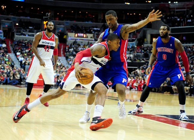 Jan 18, 2014; Washington, DC, USA; Washington Wizards guard Bradley Beal (3) is defended by Detroit Pistons guard Kentavious Caldwell-Pope (5) in the fourth quarter at Verizon Center. Mandatory Credit: Evan Habeeb-USA TODAY Sports
