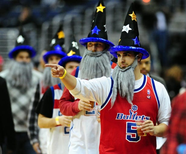 Jan 18, 2014; Washington, DC, USA; Washington Wizards fans wear wizard hats during the game against the Detroit Pistons at Verizon Center. Mandatory Credit: Evan Habeeb-USA TODAY Sports