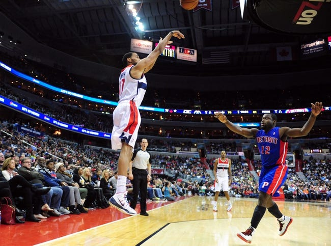 Jan 18, 2014; Washington, DC, USA; Washington Wizards guard Garrett Temple (17) shoots the ball over Detroit Pistons guard Will Bynum (12) at Verizon Center. Mandatory Credit: Evan Habeeb-USA TODAY Sports