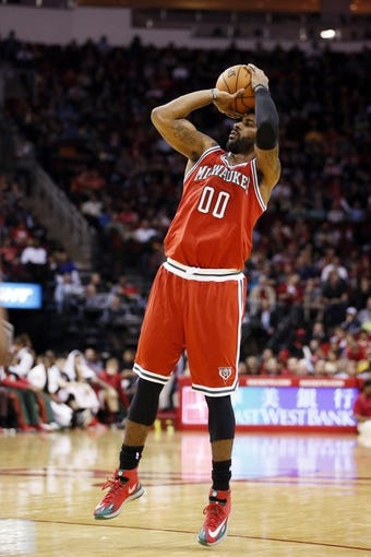 Jan 18, 2014; Houston, TX, USA; Milwaukee Bucks guard O.J. Mayo (0) shoots against the Houston Rockets during the second half at Toyota Center. The Rockets won 114-104. Mandatory Credit: Soobum Im-USA TODAY Sports