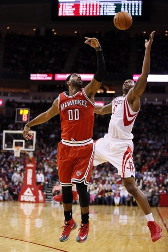Jan 18, 2014; Houston, TX, USA; Milwaukee Bucks guard O.J. Mayo (0) has the ball stolen by Houston Rockets forward Terrence Jones (6) during the second half at Toyota Center. The Rockets won 114-104. Mandatory Credit: Soobum Im-USA TODAY Sports