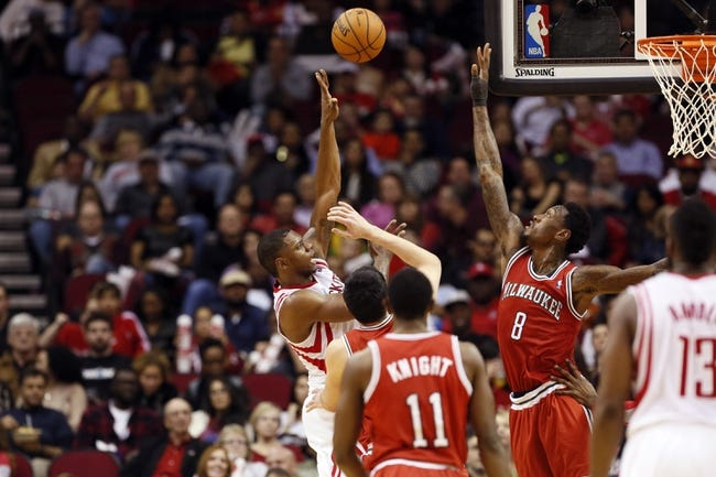 Jan 18, 2014; Houston, TX, USA; Houston Rockets forward Terrence Jones (left) takes a shot over Milwaukee Bucks center Larry Sanders (8) during the second half at Toyota Center. The Rockets won 114-104. Mandatory Credit: Soobum Im-USA TODAY Sports