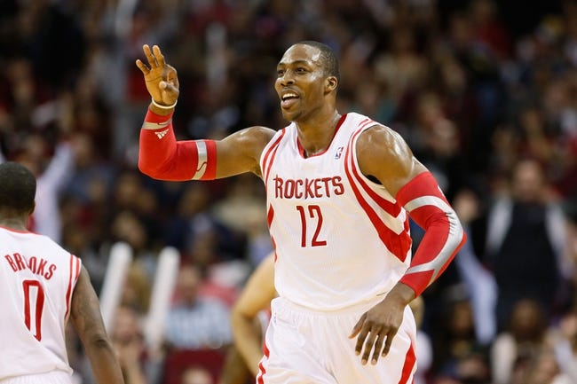 Jan 18, 2014; Houston, TX, USA; Houston Rockets center Dwight Howard (12) celebrates a three point shot during the second half against the Milwaukee Bucks at Toyota Center. The Rockets won 114-104. Mandatory Credit: Soobum Im-USA TODAY Sports